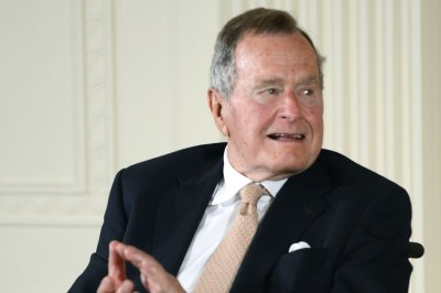George H.W. Bush apologizes amid sexual assault allegation