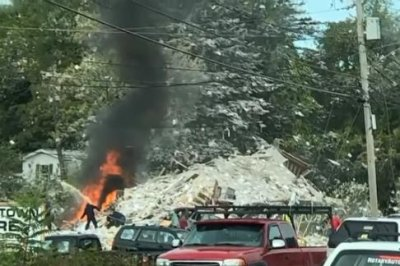 Maine building explosion kills 1 firefighter, hospitalizes 7