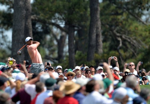 Woods in spotlight on Masters eve