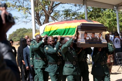 Mugabe, Zimbabwe's founding father, buried 3 weeks after death