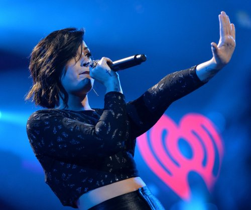 Demi Lovato slips during poolside concert