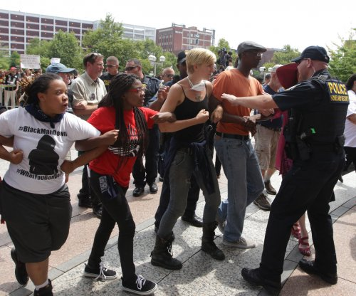 DOJ: Police response to Ferguson protests exacerbated tensions