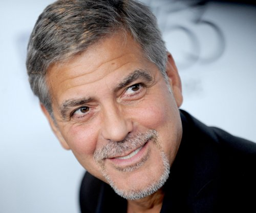 George Clooney grabs breakfast and aids homeless while in Scotland