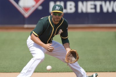 Danny Valencia's three homers lead Oakland Athletic's past Tampa Bay Rays
