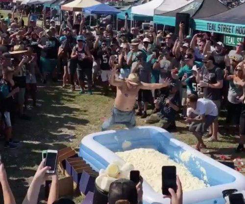 Jacksonville Jaguars fans jump into inflatable pools filled with mayonnaise