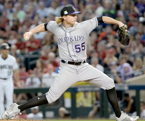 Rockies open long homestand against Reds