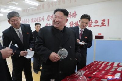 Kim Jong Un 'applauds' North Korea glass factory during visit