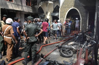 At least 207 killed, 450 hurt in eight church, hotel bombings in Sri Lanka