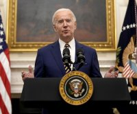 Biden to sign orders for $15 minimum wage, aid for low-income families