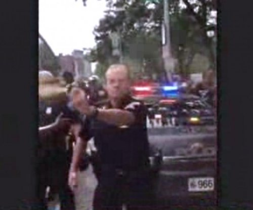 Cleveland police officer filmed pepper-spraying crowd of activists
