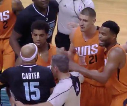 Watch: Vince Carter drills Devin Booker with elbow uppercut, gets ejected