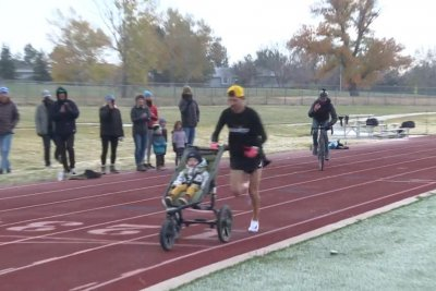 Colorado man sets world record for running mile while pushing stroller