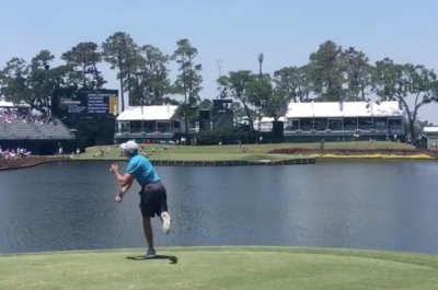 The Players Championship: Caddie tosses ball onto green at TPC Sawgrass