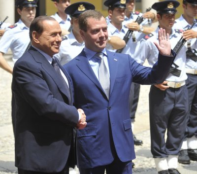 Italy's Berlusconi reports for community service