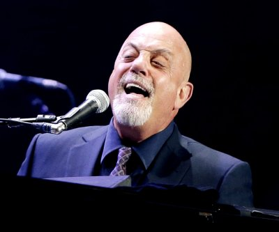 Billy Joel marries pregnant girlfriend Alexis Roderick at his Long Island estate
