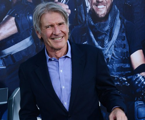 Harrison Ford drops in on couple's wedding via helicopter