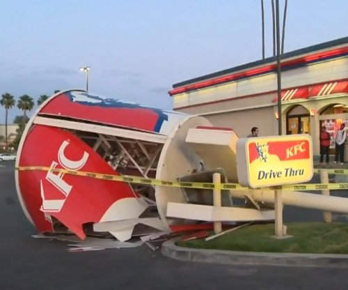 Strong winds knock down giant KFC bucket in Los Angeles