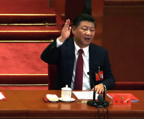 China's communists add Xi Jinping alongside Mao Zedong in constitution