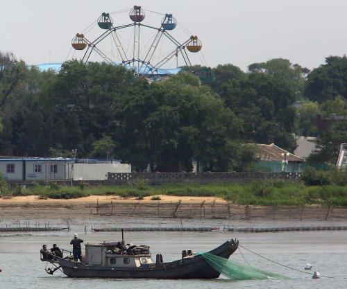 Japan repatriates six North Koreans found at sea