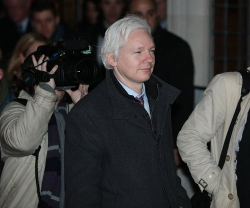 London withdraws officers outside embassy securing Assange