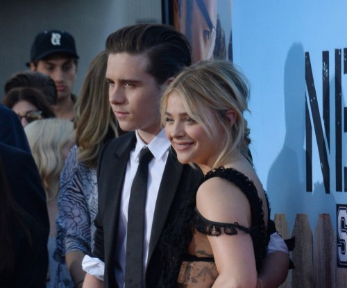 Chloe Grace Moretz cuddles up to Brooklyn Beckham on set