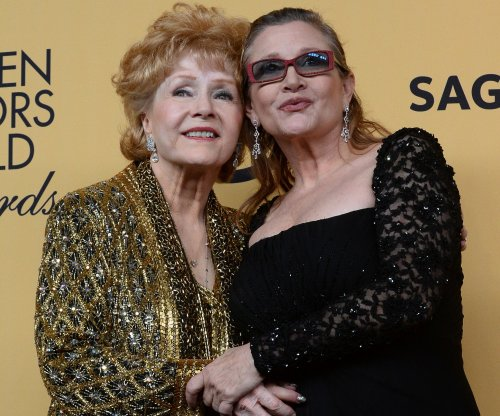 Mother-daughter screen stars Carrie Fisher and Debbie Reynolds to be buried together