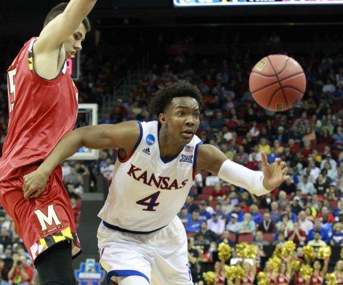 Kansas Jayhawks' Devonte' Graham will return for senior season