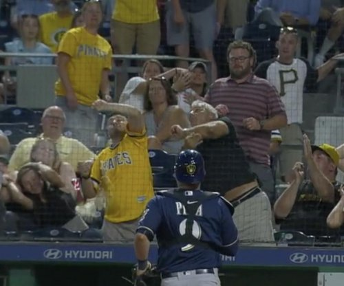 Pirates fan prompts beer tornado while trying to catch foul ball