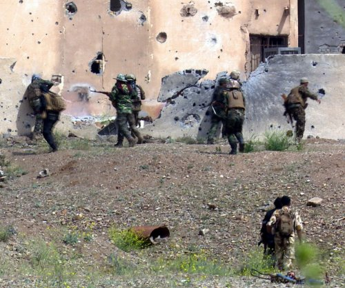 Iraq pulls Shia militias from Tikrit amid reports of looting, arson, executions