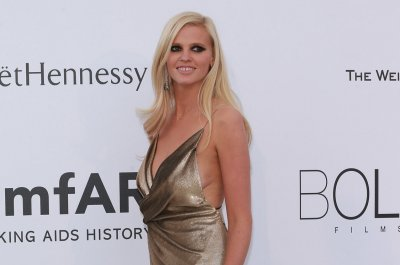 Lara Stone wears wedding ring to Cannes amfAR gala