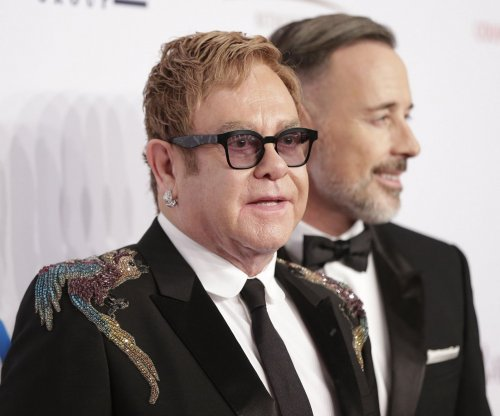 Elton John says he's 'resting well' after rare infection
