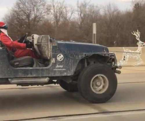 'Santa' takes to the highway on Jeep 'sleigh' pulled by 'Rudolph'