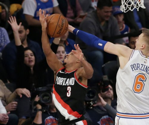 Blazers, McCollum roll into meeting with Raptors
