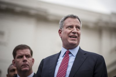 Mayor de Blasio says New York will settle stop-and-frisk suits