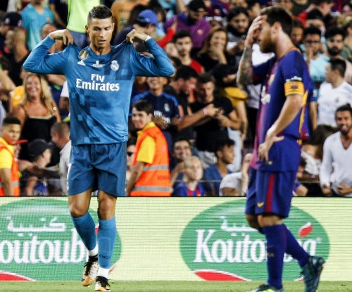 Real Madrid's Cristiano Ronaldo copies Lionel Messi celebration, pushes referee