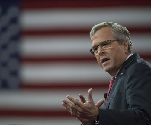 GOP presidential hopefuls rip Obama; Bush defends religion in public life