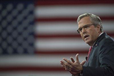 GOP presidential hopefuls rip Obama; Bush defends religion in public life