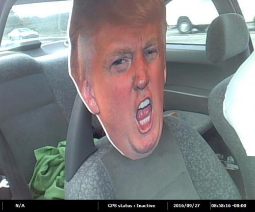 Alleged carpool lane cheater used cardboard Donald Trump head