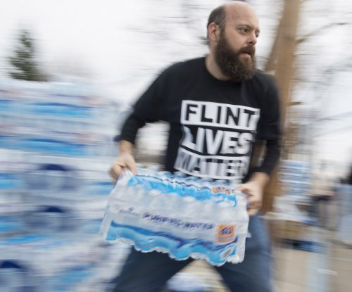 Four more officials charged in Flint water crisis