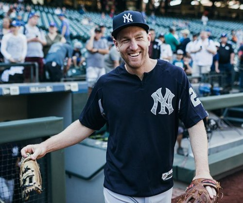 New York Yankees survive Todd Frazier triple play, top Cincinnati Reds