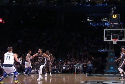 Dallas Mavericks' Luka Doncic drills half court 3-pointer