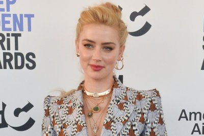 Amber Heard mourns mom Paige's death: 'I am heartbroken'