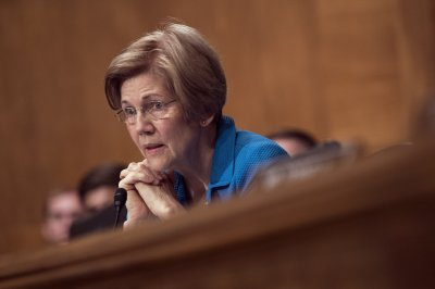 Elizabeth Warren slams Trump nominee to consumer agency