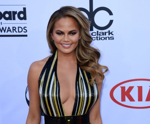Chrissy Teigen unfazed by woman's fall as she enters Billboard stage