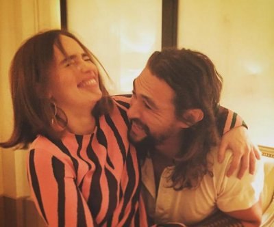 Emilia Clarke, Jason Momoa reunite at Paris Fashion Week