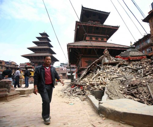 New photos show the people of Nepal dealing with the rubble from the earthquakes