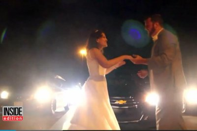 Newlyweds have first dance on highway when traffic jam keeps them from reception