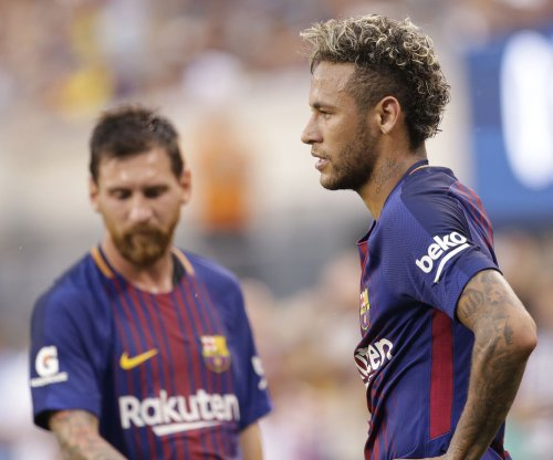 Barcelona's Lionel Messi says goodbye to teammate Neymar