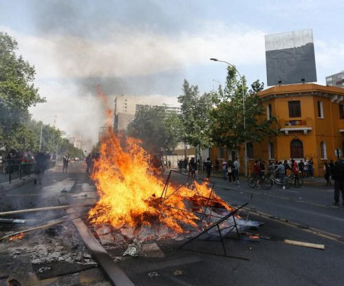 Chile suspends Metro price hike after 3 die in supermarket fire