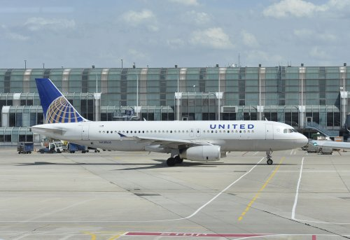 Evacuation slide deploys in middle of United Airlines flight